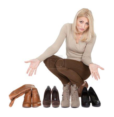 Beautiful young woomen choosing shoes to wear