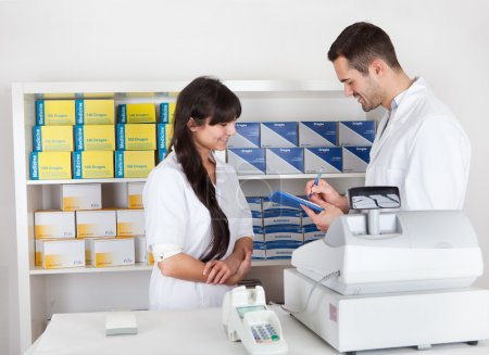 Pharmacists checking drugs