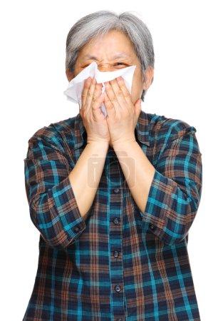 Sneezing mature asian woman
