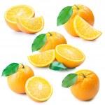 Set of fresh orange fruits with cut and green leav...