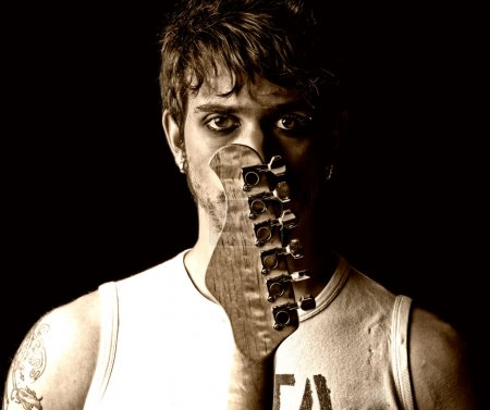 Photo for Young man with guitar portrait grunge punk rock - Royalty Free Image