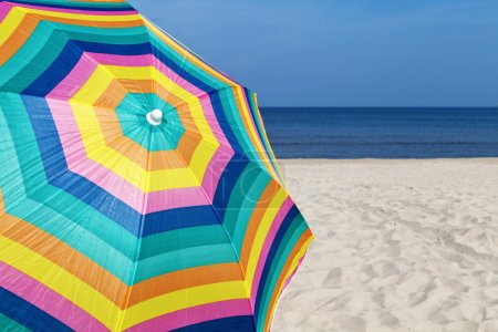 Photo for Umbrella on a sandy beach, summer time - Royalty Free Image