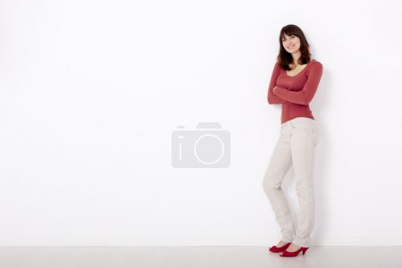 Woman against a white wall