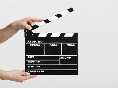 Photo for Male hands holding a clapboard, great conceptual image for ex, a new start your business - Royalty Free Image