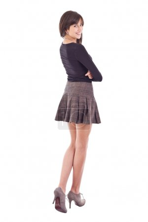 Photo for Beautiful smiling teenage girl posing in short skirt - Royalty Free Image