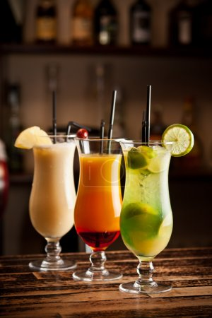 Photo for Three fresh cocktails on a bar table - Royalty Free Image