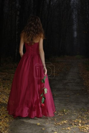 Girl in the night autumn forest