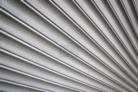 Photo for Metal security shutters protecting a small shop when closed - Royalty Free Image