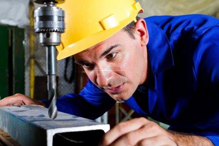 Metal worker using drillpress