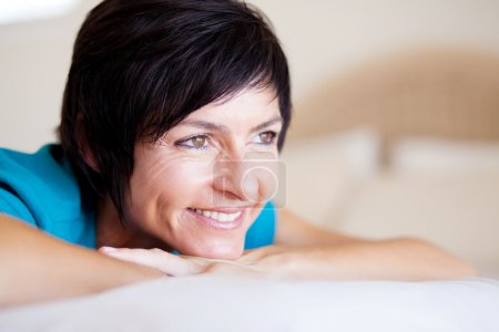 Middle aged woman daydreaming