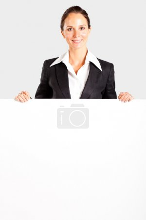 Photo for Pretty mid age businesswoman behind white board - Royalty Free Image