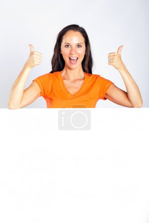 Photo for Cheerful woman thumbs up with white board - Royalty Free Image