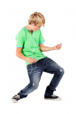 Teen boy playing air guitar