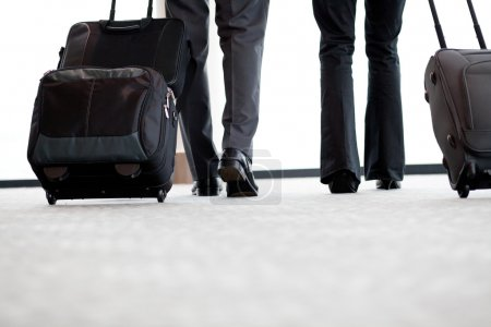 Photo for Business travellers walking in airport with luggage - Royalty Free Image