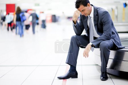 Photo for Worried businessman lost his luggage at airport - Royalty Free Image