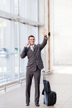 Businessman waving good bye