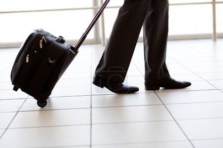 Silhouette of businessman walking in airport