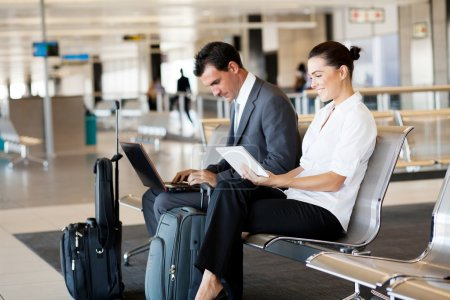 Photo for Business travellers waiting for their flight at airport - Royalty Free Image