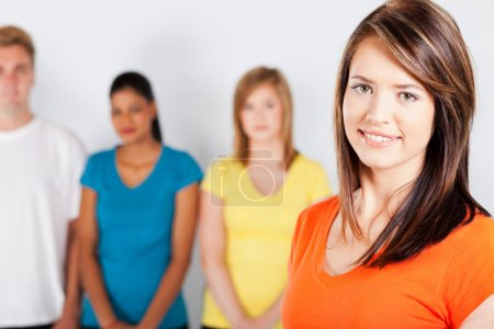 Young woman standing in front of group of