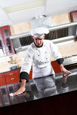 Professional chef cleaning in commercial kitchen