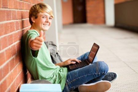 Teenage student thumb up