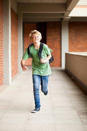 Middle school student running in school passage