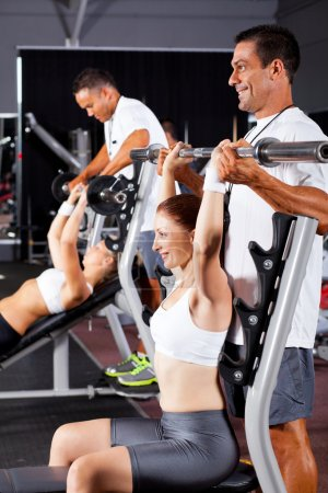 Fitness women and personal trainers