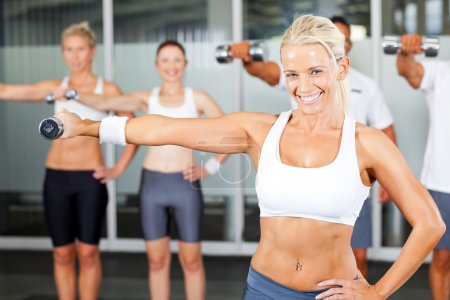 Photo for Group of exercise in gym with dumbbells - Royalty Free Image