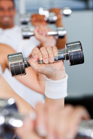 Photo for Exercise with dumbbell in gym - Royalty Free Image