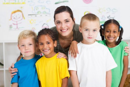 Photo for Group of preschool kids and teacher portrait in classroom - Royalty Free Image