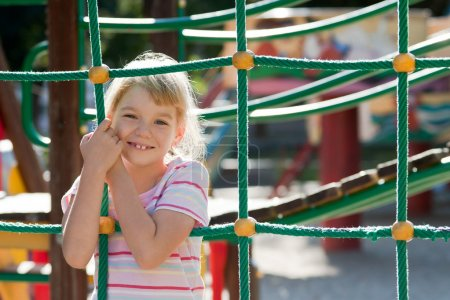Photo for Little girl on the playground having fun at summer time. - Royalty Free Image