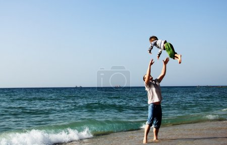 Child with his father at sea