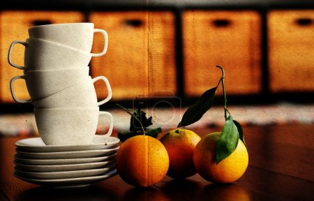 White cups and organic oranges. soft Focus