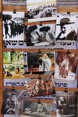 Old pictures on the door of shops ultra-orthodox district of Jerusalem - M