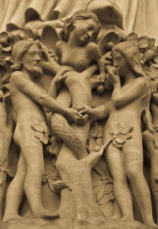 Photo for Detail on Notre Dame de Paris Cathedral fachade: Adame, Eve and the forbidden apple - Royalty Free Image