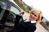 Smiling blonde with car keys