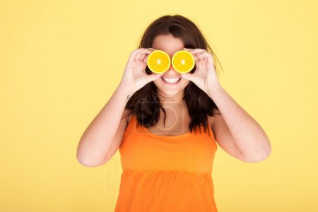 Woman Having Fun With Oranges