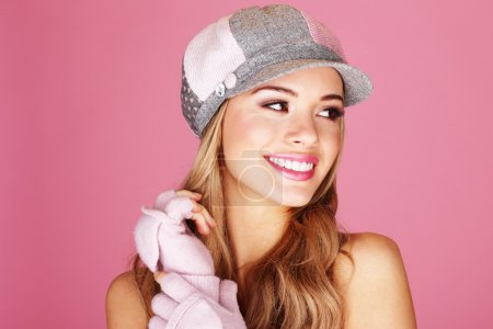 Photo for A pretty blonde woman giving a beautiful big smile wearing corduroy cap - Royalty Free Image