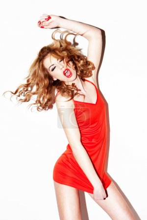 Vivacious Redhead Singing And Dancing