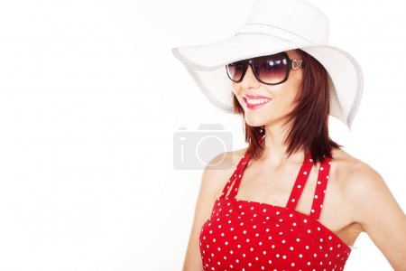 Photo for Smiling female with hat and sunglasses on white background - Royalty Free Image