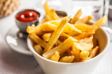 Photo for Golden French fries potatoes ready to be eaten - Royalty Free Image