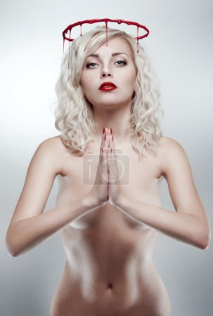 Photo for Young blonde praying woman with bloody nimbus - Royalty Free Image