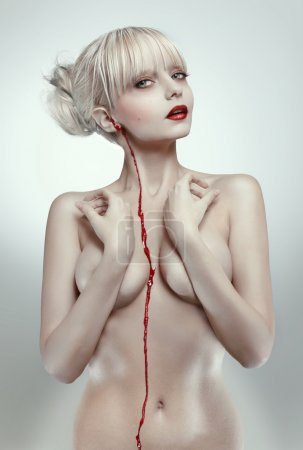 Blonde bleeding woman