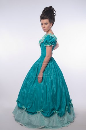 Old fashioned girl in cyan dress