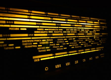 Radio scale on black background, old radio close u...
