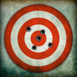 Target with bullet holes, grunge background...