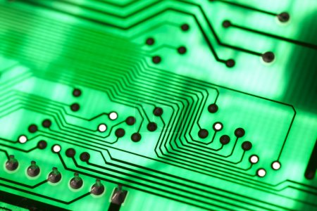 Photo for Closeup of a green computer circuit board technological background - Royalty Free Image