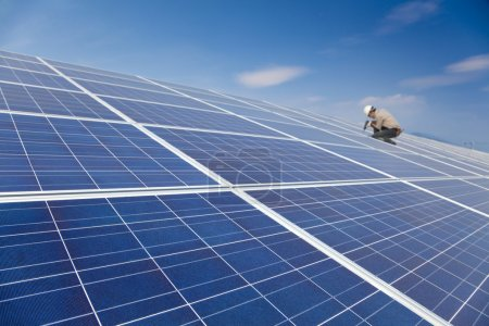 Close up solar panel and professional worker installing photovoltaic solar