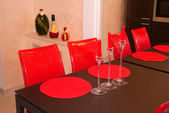 Red chairs and spark candles on brown table