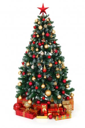 Photo for Artificial green Christmas tree, decorated with electric lights, red and golden ornaments, lots of presents under the tree - Royalty Free Image